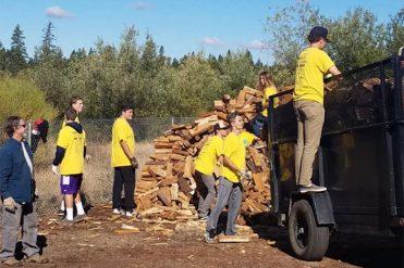Volunteers moving firewood