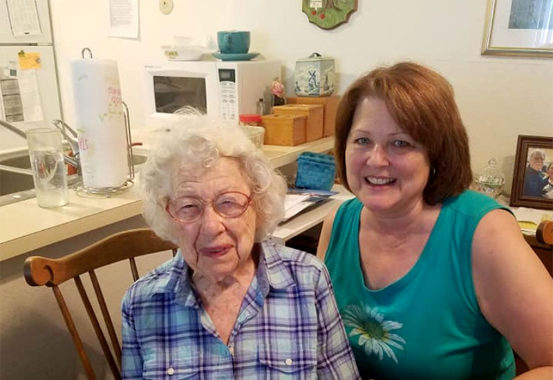 Senior woman and meals on wheels volunteer