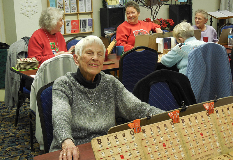 seniors playing bingo at congregate cafe